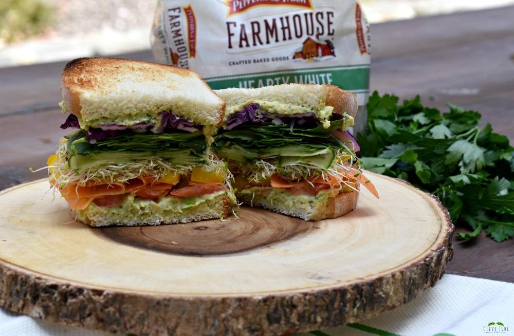 Colorful Veggie Sandwich with Chunky Chickpea Spread #BakedwithCare #FarmhouseBread #ad
