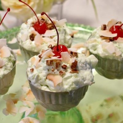 Toasted Coconut and Pecan Topped Pistachio Dessert: The Best Watergate Salad #watergatesalad #retrodessert #jellopistachopudding