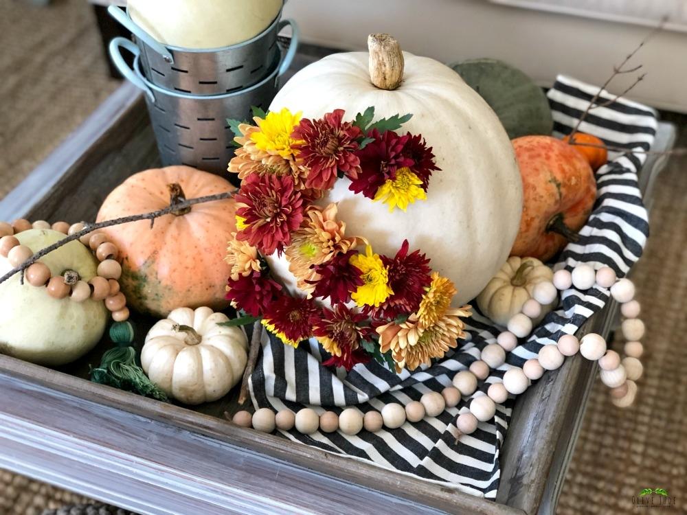 DIY: Blooming Monogrammed Pumpkin #bloomingpumpkin #floralpumpkin #pumpkincenterpiece #monogrammedpumpkin